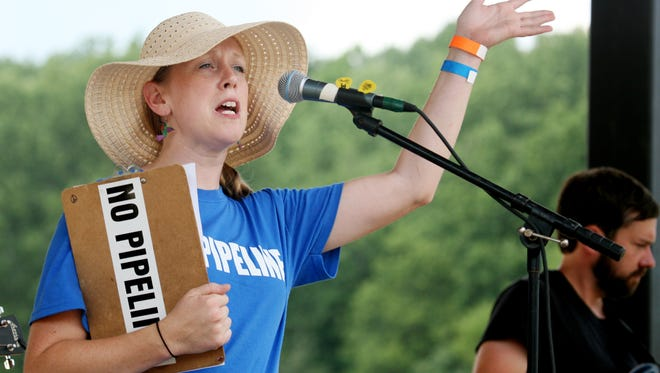 Jennifer Lewis, president of Friends of Augusta, welcomes everyone to the Music for the Mountains festival at Devil's Backbone Brewery in Roseland on Saturday, July 18, 2015. The festival was created to raise funds to fight the Atlantic Coast Pipeline.