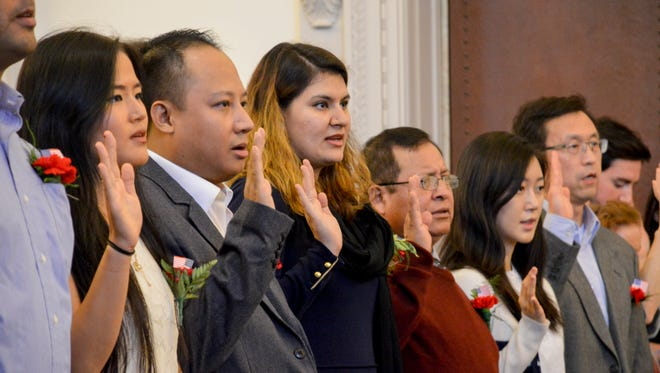 Thirty-four people were sworn in as United States citizens in a naturalization ceremony on Wednesday.