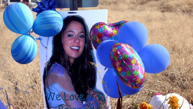 A photo of Brianna Denison at the memorial was erected where her body was found.