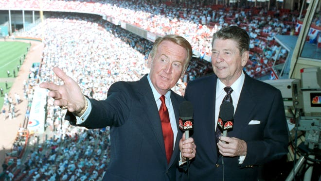 Vin Scully (left), shown with former President Ronald Reagan at the 1989 All-Star Game in Anaheim, left CBS for NBC in 1982.