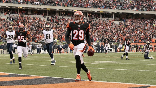 Former Bengals strong safety Leon Hall (29) runs back an interception for a touchdown last year against St. Louis.