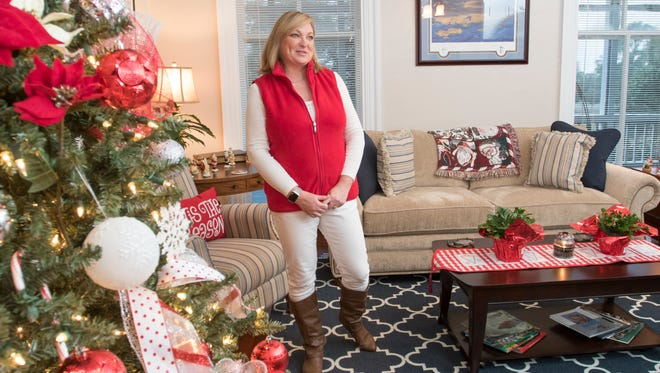 Catherine Martin, wife of Capt. Christopher Martin, commander of Pensacola Naval Air Station, talks about decorating their home for Christmas  in Pensacola.   Capt. and Mrs. Martin's house, one of several historic houses on base, dates to the early 1900's.