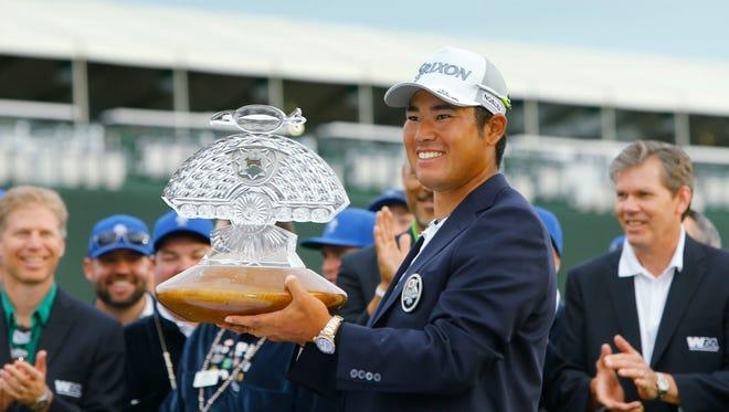 Hideki Matsuyama hoists the trophy following his playoff win in the  2017 Waste Management Phoenix Open on Feb. 5  in Scottsdale,  Ariz.