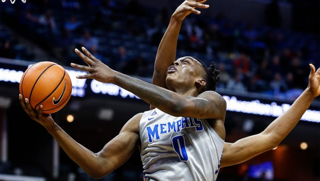 Memphis forward Kyvon Davenport is fouled by the Houston defense during first half action at the FedExForum in Memphis Tenn., Thursday, February 22, 2018.