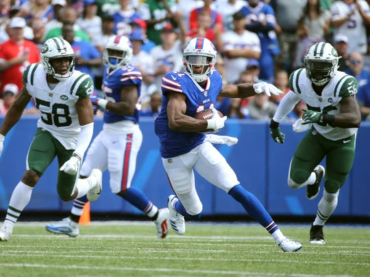 Bills rookie receiver Zay Jones looks for yards after a catch against the Jets.