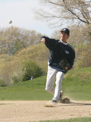 John Siever throws out the first pitch before the last home game at the former Plymouth North High School baseball field.