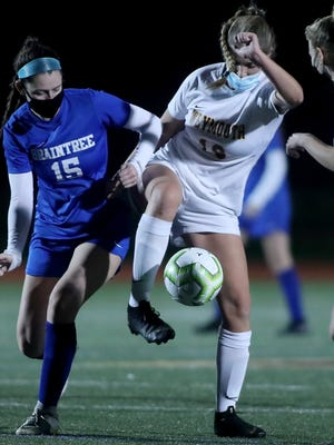 WeymouthþÄôs Grace McDermott and BraintreeþÄôs Julianne Stones battle for possession in the midfield during second quarter action of their game at Weymouth High on Wednesday, Nov. 4, 2020.