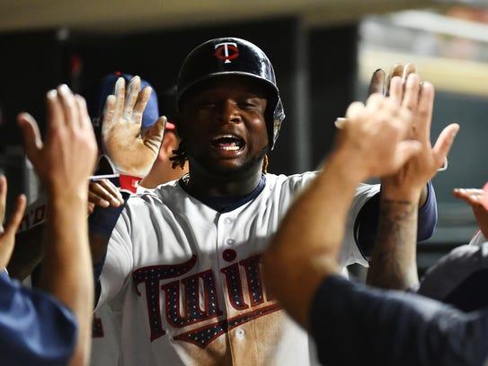 Minnesota Twins third baseman Miguel Sano is congratulated