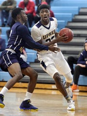 Jeenathan Williams, right, averaged 22 points, 7 rebounds and 5 assists last season for UPrep, which was was Section V Class AA Tournament runner-up to Fairport.