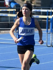 Lakeland's Madeline Rehm runs a leg in the 4 x 800-meter