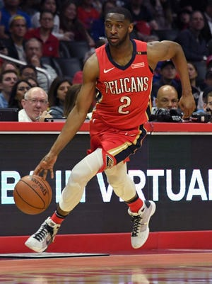 Pelicans guard Ian Clark dribbles the ball against the Clippers.