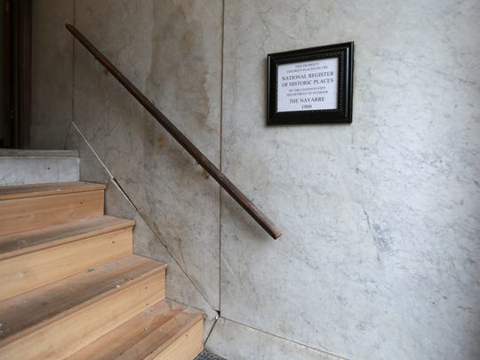 Stairs at the Navarre have been repaired, but city officials say other improvements have stalled.