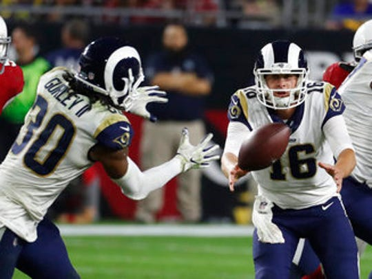 Rams quarterback Jared Goff (16) pitches the ball to running back Todd Gurley against the Arizona Cardinals last season. Gurley rushed for 1,305 yards last season, second in the NFL.