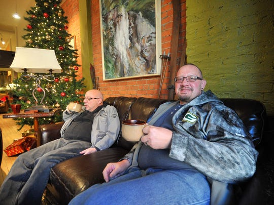 Jim Mueller, right, and Jeff McDonald, both of Wausau, enjoy their coffees Friday afternoon at Allister Deacon's Coffee House in downtown Wausau.