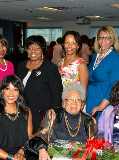 Members of the African-American Women's Giving and Empowerment Circle surround Jean Fairfax (front center).