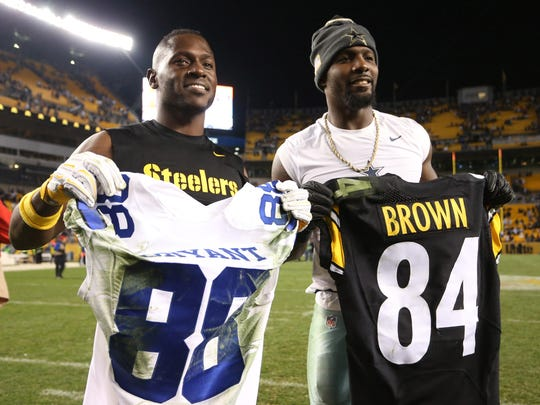 Dallas Cowboys wide receiver Dez Bryant (R) and Pittsburgh Steelers wide receiver Antonio Brown (L) exchange game jerseys after their game at Heinz Field in 2016. While Brown has continued to be widely regarded as the best in the sport, Bryant's star has fallen as he seeks a new team following his release by the Cowboys.