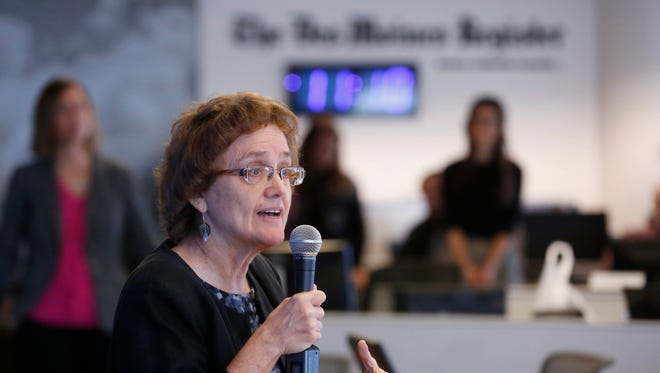 Former news director Carol Hunter speaks to the newsroom Tuesday, Nov. 15, 2016, after named as the new executive editor of The Des Moines Register.