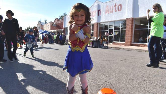 Leicey Astorga, 4, shows off her Wonder Woman costume during Saturday's  Halloween on Granado Street festival.