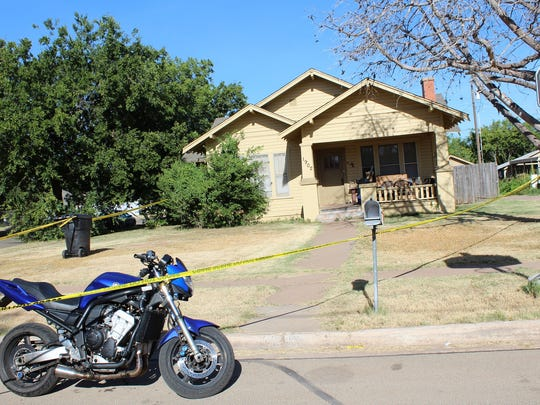 Police tape surrounds a home at the corner of Swenson