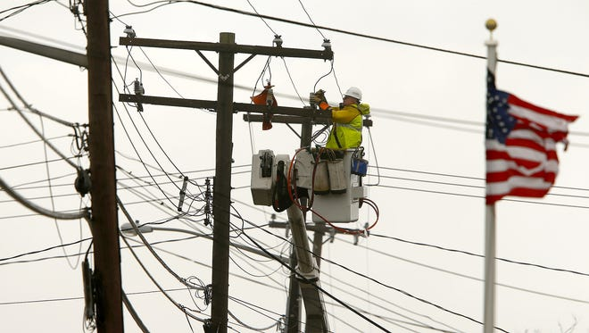 A JCP&L lineman works to repair wires along Main Avenue in Bay Head in April.