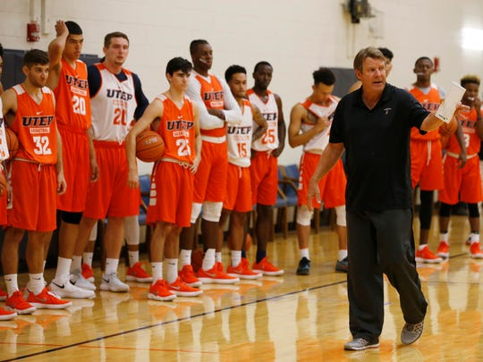 UTEP head coach Tim Floyd calls his team together Monday