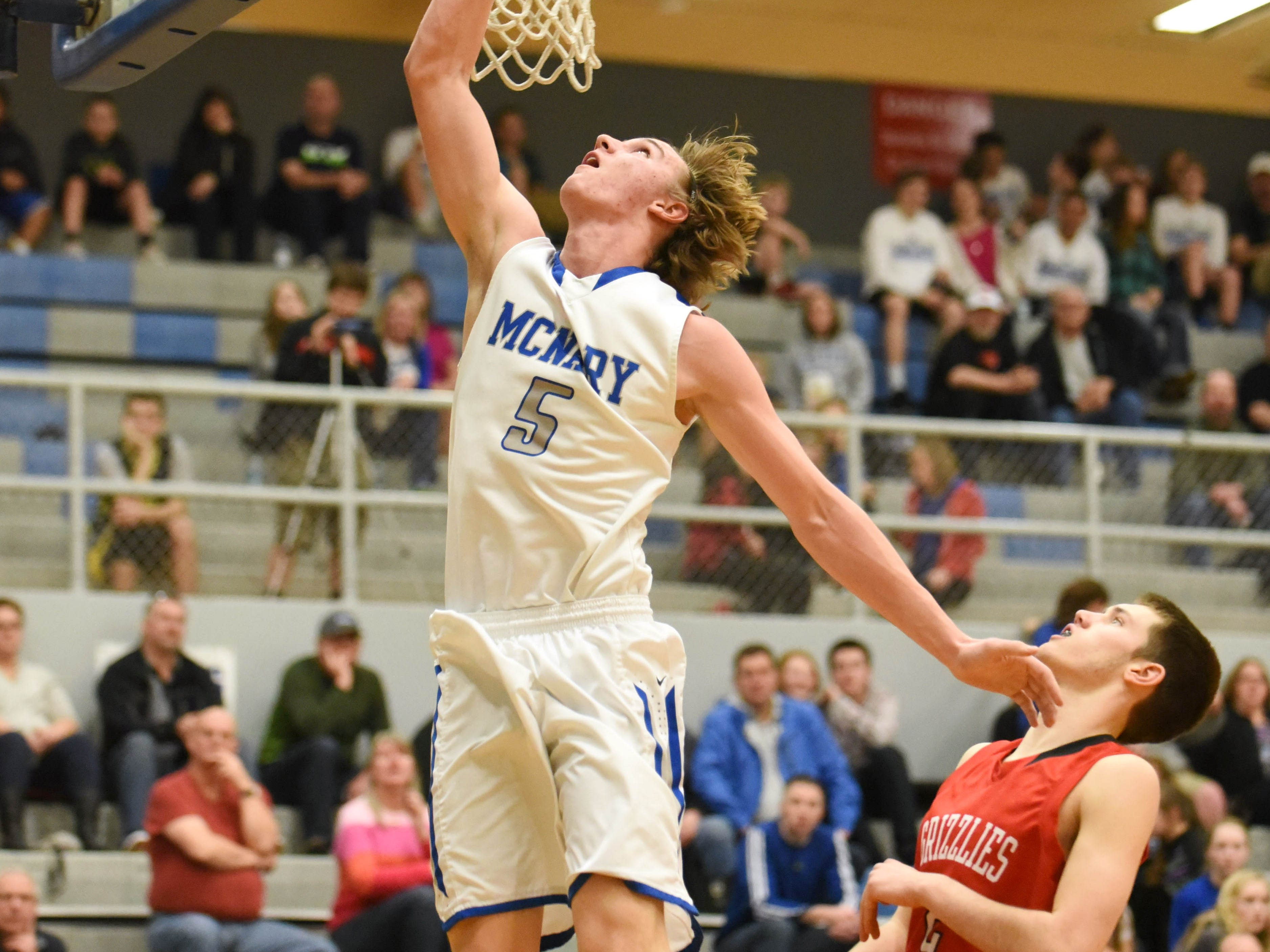 McNary's Devon Dunagan scores as the Celts take on McMinnville in a Greater Valley Conference game on Friday, Feb. 13, 2015.