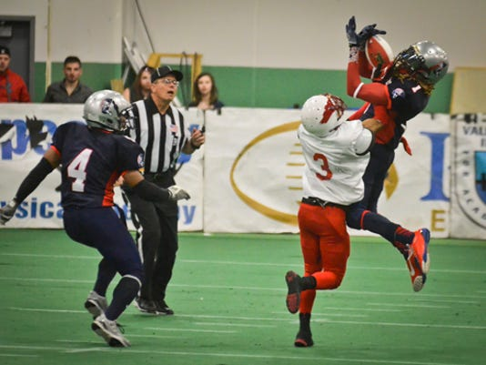 York Capitals defensive back Archie Smith Jr. intercepts the ball during a game from 2013 at the York City Ice Arena. The Capitals have announced they are leaving York for Harrisburg.