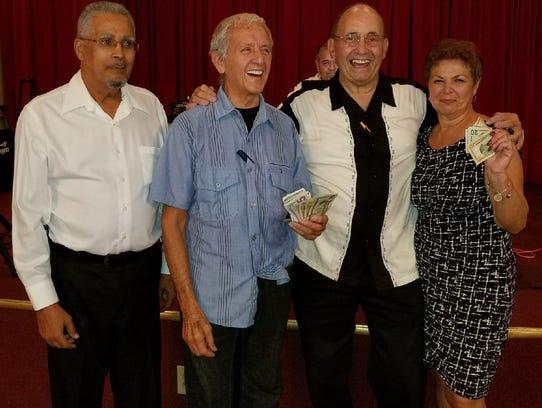 Spanish American Club Treasurer Luis Carrillo, left,