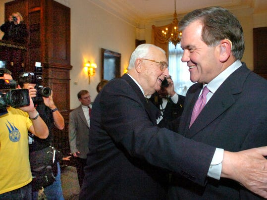 The late George Leader, left, and Tom Ridge embrace while joking around in the lobby of the Yorktowne Hotel in October 2005. Ridge was guest speaker for a dinner honoring Leader's 50th anniversary of inauguration as Governor of Pennsylvania. (FILE)