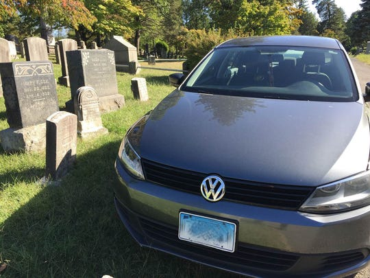 This car from Connecticut parked atop the grave of
