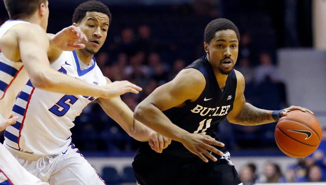 Butler guard Kethan Savage, right, drives as he looks to pass against DePaul guard Billy Garrett Jr., center, and forward Joe Hanel during the first half of an NCAA college basketball game, Saturday, Jan. 21, 2017, in Rosemont, Ill.