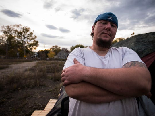 Nick Walls stands outside his new spot on Monday night, Oct. 23, 2017, a stone's through away from his old campsite on public land off Sears Lane in Burlington's South End. Last week, the city forced Walls and others at the camp out, citing public safety concerns.