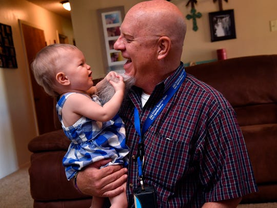 Auree Anders grabs a handful of beard hanging from the chin of Reporter-News editor and columnist Greg Jaklewicz on Tuesday. Auree is one of the quadruplets born to Tuscola's Meagan Anders a year ago and Jaklewicz returned to the home for a follow-up story.
