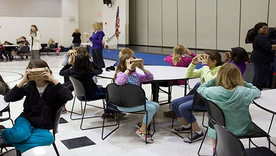 Students at a valley charter school had the opportunity to test Google Cardboard, a virtual reality device.