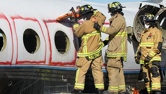 Mesa Fire and Medical Department firefighters cut out the windows of a Gulfstream Jet during a training exercise.