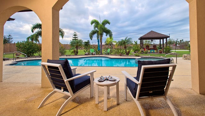 PHOTO BY EDDIE SEAL/SPECIAL TO THE CALLER TIMESA stunning view from the veranda overlooking the salt water swimming pool and the lushly landscaped 1.06 acre lot in Flour Bluff