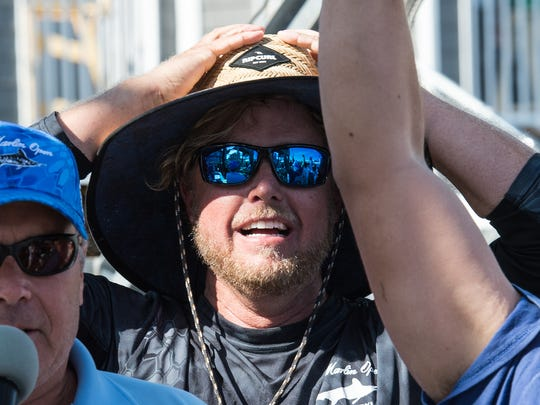 Kevin Rohe, of Ocean City, eagerly awaits the final weight of his crew's white marlin on Friday, Aug. 11, 2017. The 95.5 pound fish was the largest of the tournament and third largest in the White Marlin Open's history.