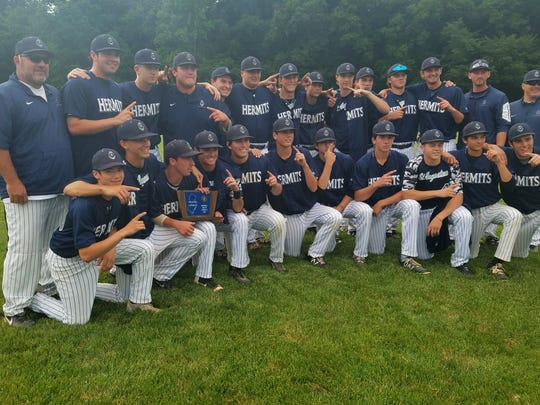 St. Augustine's baseball team poses with its Non-Public A South trophy. The Hermits beat Bishop Eustace, 4-3 in eight innings on Wednesday at Rider University, to acquire the prize.