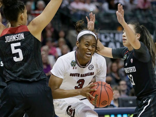 South Carolina guard Kaela Davis (3) is pressured by Stanford forward Kaylee Johnson (5) and guard Marta Sniezek (13) during the first half of an NCAA college basketball game in the semifinals of the women's Final Four, Friday, March 31, 2017, Friday, March 31, 2017, in Dallas. (AP Photo/LM Otero)