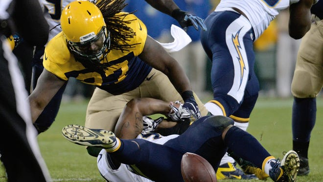 San Diego Chargers linebacker Tourek Williams causes Green Bay Packers running back Eddie Lacy to fumble in the fourth quarter at Lambeau Field on Oct. 18.