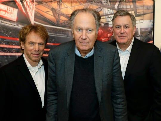 From left, Hollywood producer Jerry Bruckheimer, billionaire