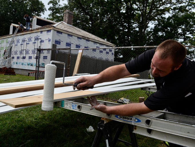 Shane Schmidt, of Radatz Contracting, paints a siding board on the Fort Gratiot Hospital Wednesday, Aug. 20 at the Fort Gratiot Light Station.