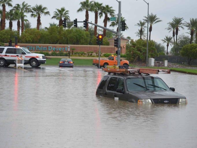 Palm Springs Ford >> Rain in Palm Desert floods roads, strands vehicles