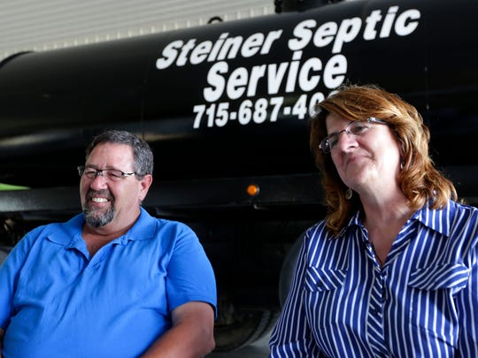 Steve and Debby Steiner, owners of Steiner Septic Service, smile during an interview with USA TODAY NETWORK-Wisconsin reporters in their rebuilt shop, July 12, 2016. It burned to the ground, but through community support managed to rebuild.