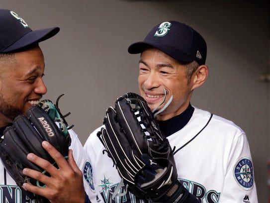 Seattle Mariners' Ichiro Suzuki, right, and Robinson