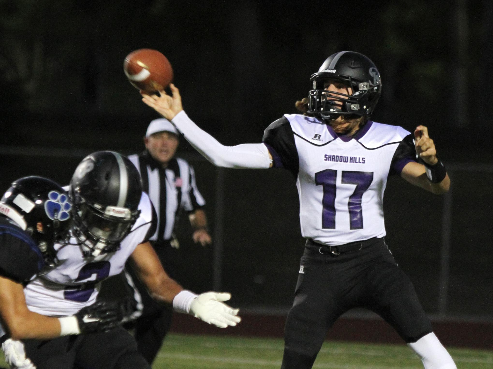 Shadow Hills quarterback Jason Lang throws the ball during the first half against Cathedral City High School on Friday.