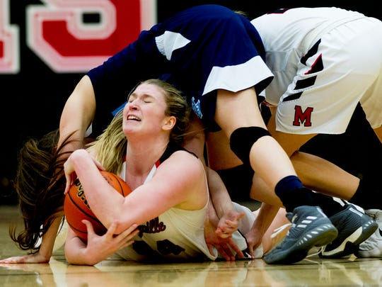 Maryville's Lindsey Taylor (44) grabs a loose ball