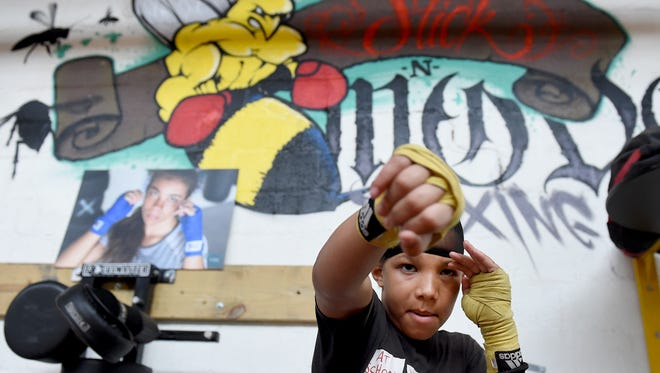 A bee representing the fighting style of Muhammad Ali is on the wall behind Antwoine Dorm, Jr. as he trains in his father's gym, Stick-N-Move. 'He's a big influence to me, big time as far as the things he stood for and what he did in the ring as well,' said Antwoine Dorm, Sr. of Muhammad Ali, who died Friday at the age of 74.
