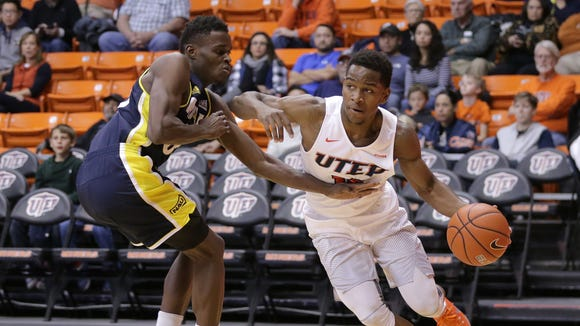 UTEP's Dominic Artis tried to get around NAU's Aziz Deck in a game earlier this season.