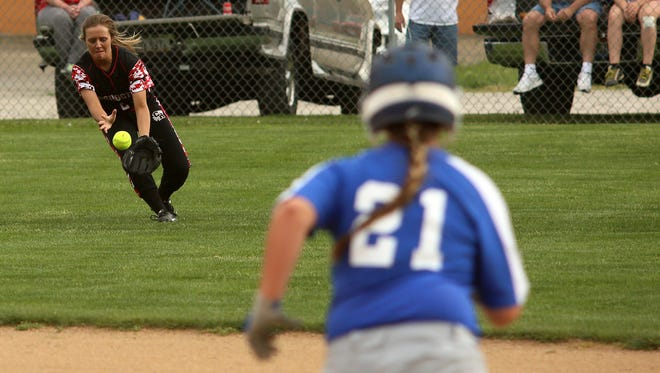 Coshocton's Payton Holdsworth fields the ball as Zanesville's Erin Lee runs to second Friday during Coshocton's 18-0 victory in five innings.